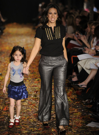 Melissa Gernstein (with her daughter), co-owner of