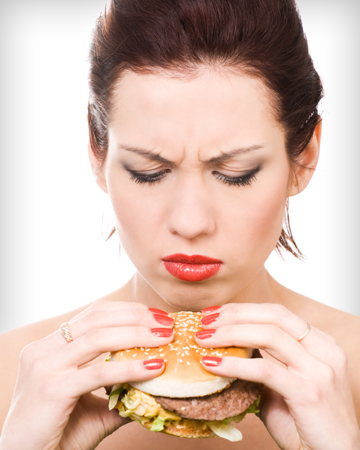 Woman looking at hamburger