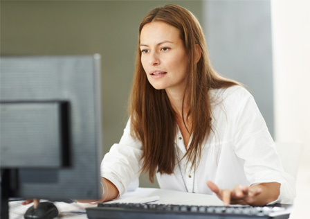 Woman concentrating on computer