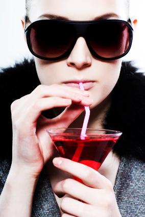 Woman drinking a martini