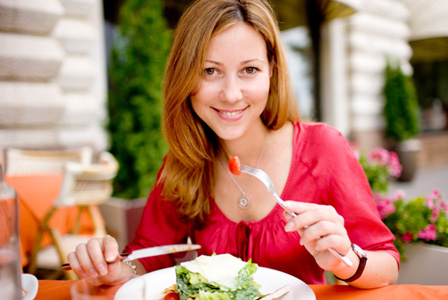 Woman eating heart healthy salad