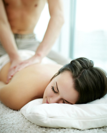 Woman geting massage from man