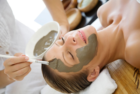 Woman getting mud mask at spa