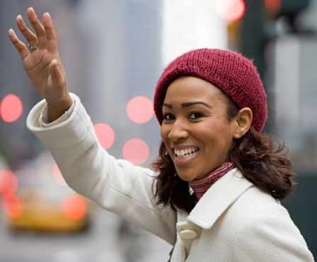 Woman hailing a cab