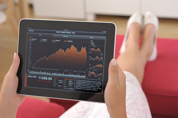 Woman looking at stocks on iPad