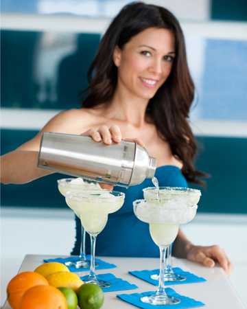 Woman making margarita