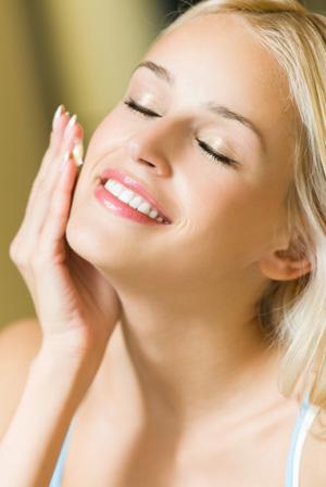 Woman applying self-tanner