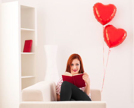 Woman reading book on Valentine's day