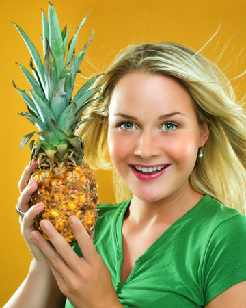 Woman with pineapple