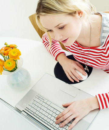 Woman writing email from home