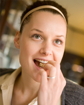 Woman eating whole grains