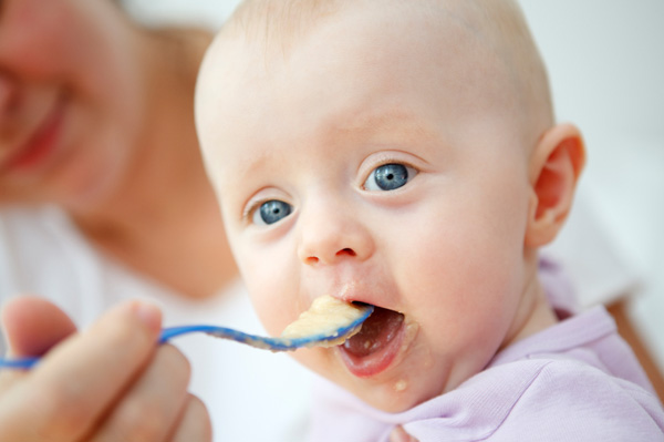 Baby eating homemade baby food