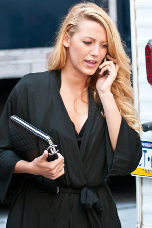 Blake Lively uses her iPhone and iPad on the go