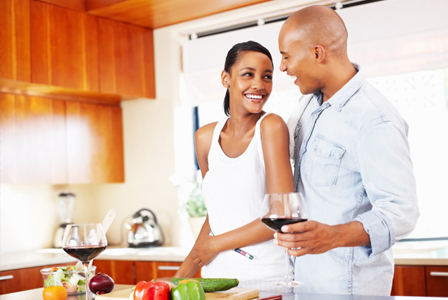 Couple cooking with wine