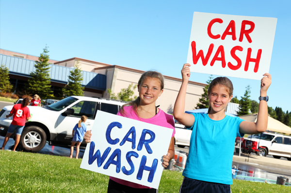 Children at a fundraiser car wash