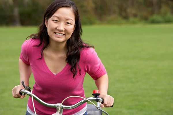 Happy woman on bike