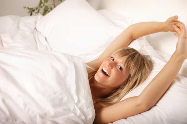 refreshed woman waking up