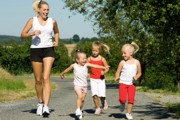 Mum running with daughters