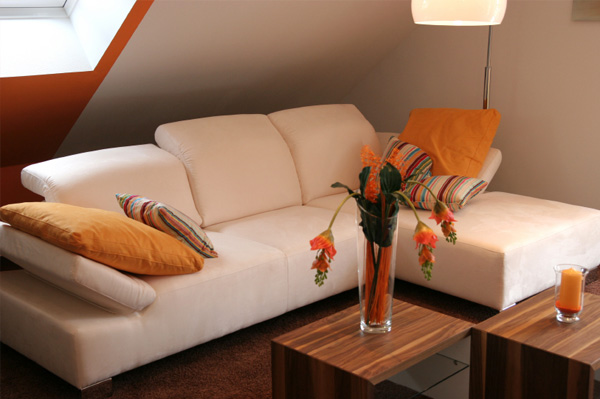 Simple orange accented living room