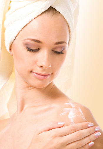 woman applying lotion in towel