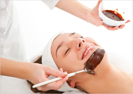 Woman getting chocolate facial