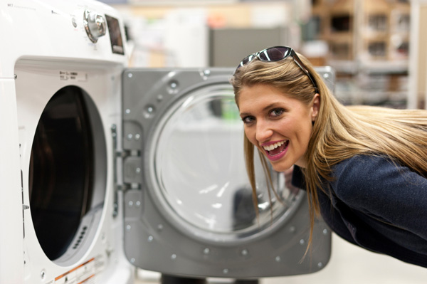Woman shopping for washing machine