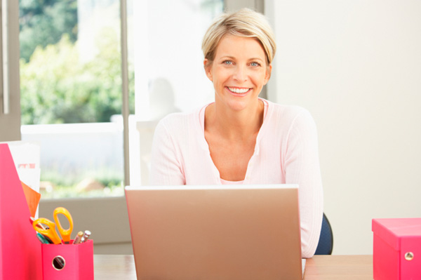 Woman spring cleaning computer