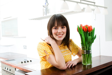 Woman in organized kitchen
