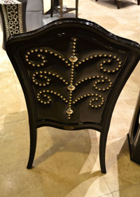 Nailheads placed in a pattern design make the back of this black chair special.