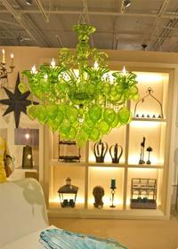 Green chandelier displayed at Cyan Design.