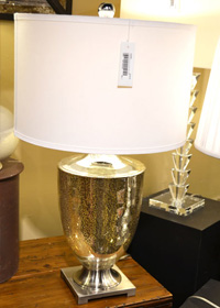 Unique mirrored surfaces like this mercury glass lamp are becoming must-have looks.