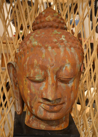 Aged patina medal creates a stunning Buddha head sculpture.