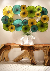 An organic-shaped side table gets a modern update with a blue and green parasol wall light.