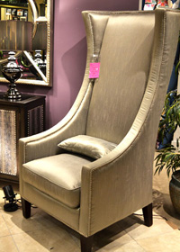 This Winmark Empress Chair features metallic nailheads that are repeated on the side-table and have a similar pattern in the mirror.