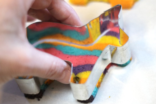 Cutting the pinata shape from baked cookies