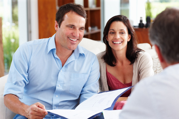 Couple meeting with financial advisors