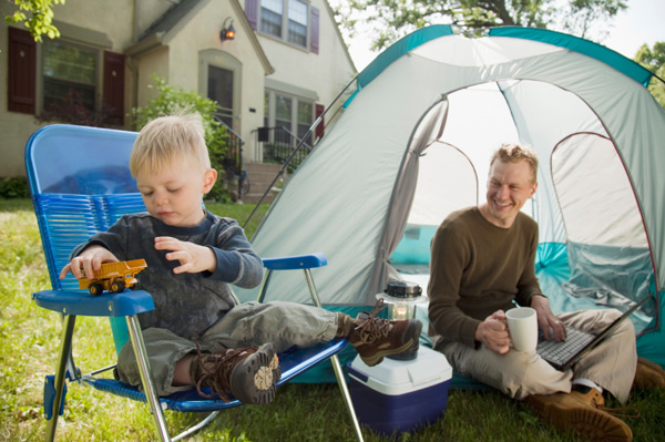 Father and son camping outside home