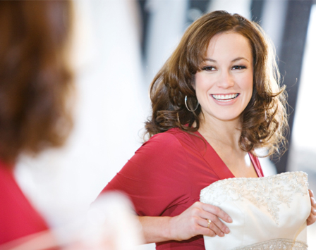 Happy woman shopping for wedding dress