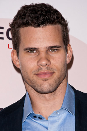 Kris Humphries poses in leather shorts