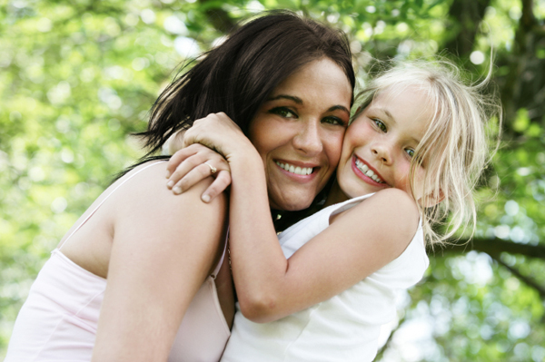 Mom hugging daughter