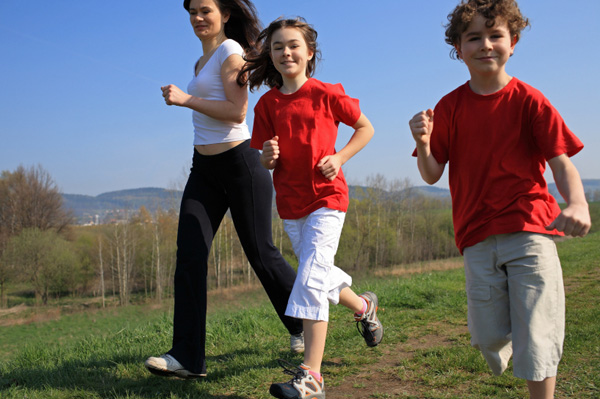 mom and kids outside running