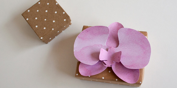 Finished DIY craft: watercolor paper orchid on a box