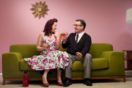 Retro couple having cocktails