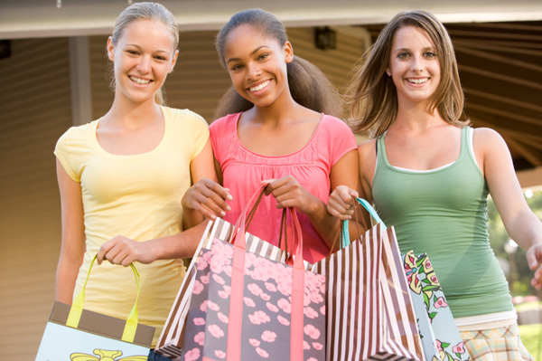 Teen girls shopping together