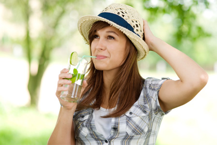 woman drinking water in garden