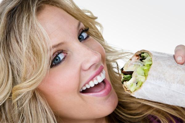 woman eating sandwich wrap