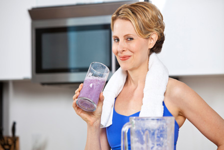 Woman drinking smoothie after workout