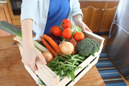 Woman with CSA produce