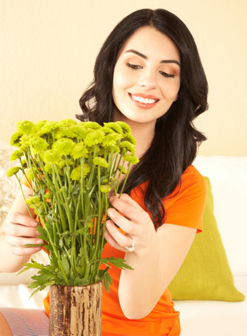 Woman with flower arrangement