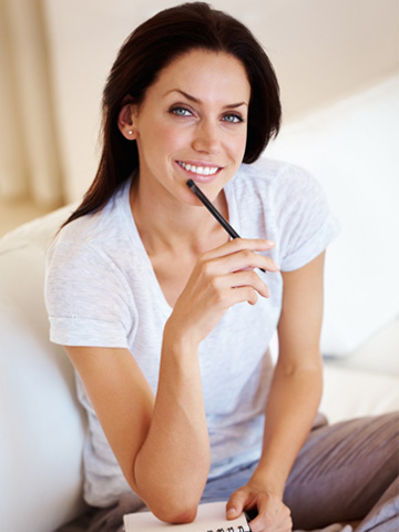 Woman working from home with list